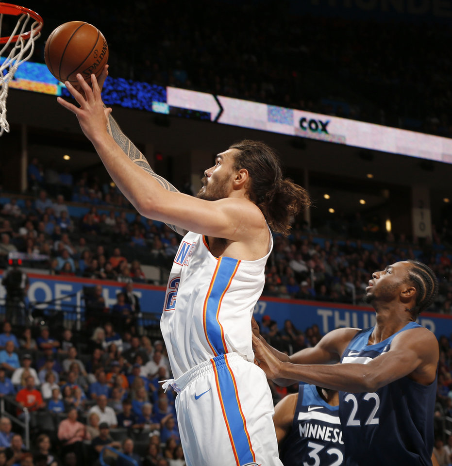Photo - Oklahoma City's Steven Adams (12) shoots in front of Minnesota's Andrew Wiggins (22) during an NBA basketball game between the Oklahoma City Thunder and the Minnesota Timberwolves at Chesapeake Energy Arena in Oklahoma City, Sunday, Oct. 22, 2017. Photo by Nate Billings, The Oklahoman