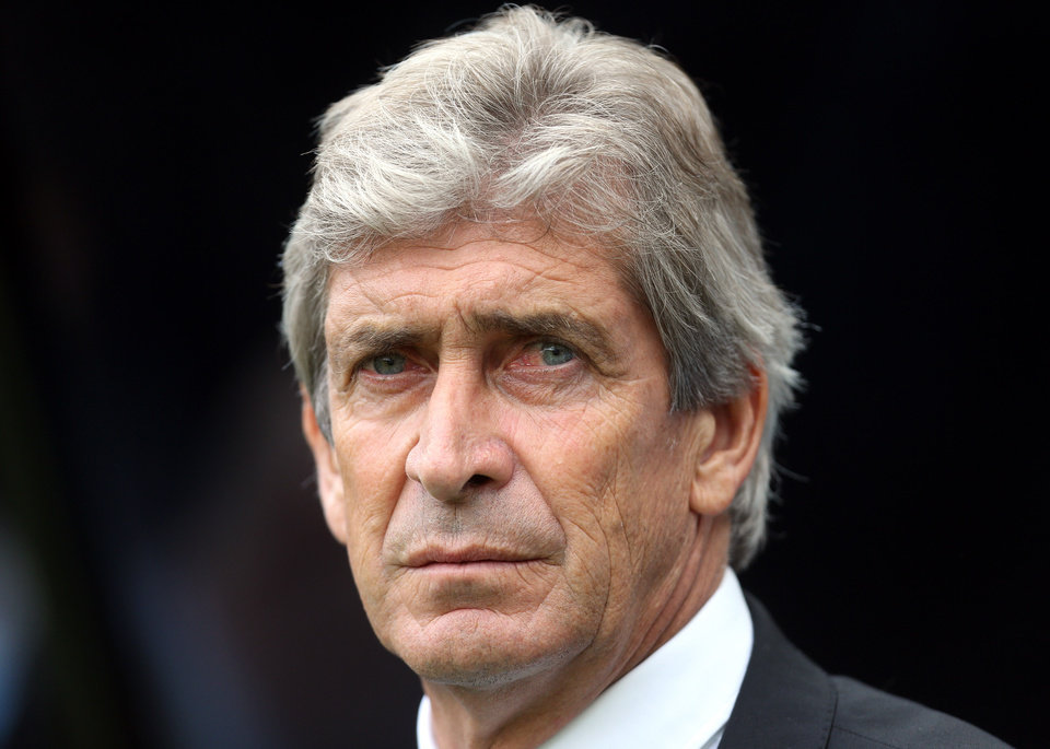 Photo - Manchester City's manager Manuel Pellegrini look's on ahead of  their English Premier League soccer match against Newcastle United at St James' Park, Newcastle, England, Sunday, Aug. 17, 2014. (AP Photo/Scott Heppell)