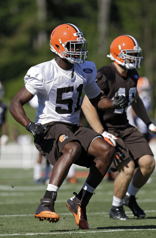 Photo - Cleveland Browns linebacker Barkevious Mingo (51) runs on kick coverage during the first training camp practice at the NFL football team's practice facility in Berea, Ohio, Thursday, July 25, 2013. (AP Photo/Mark Duncan)