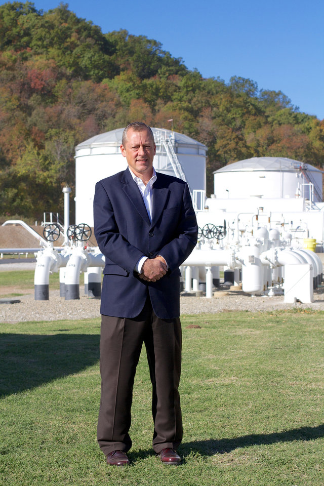 Photo - Magellan Midstream Partners CEO Mike Mears stands in front of gasoline and diesel storage tanks at the company's Tulsa terminal.  Adam Wilmoth - photo by