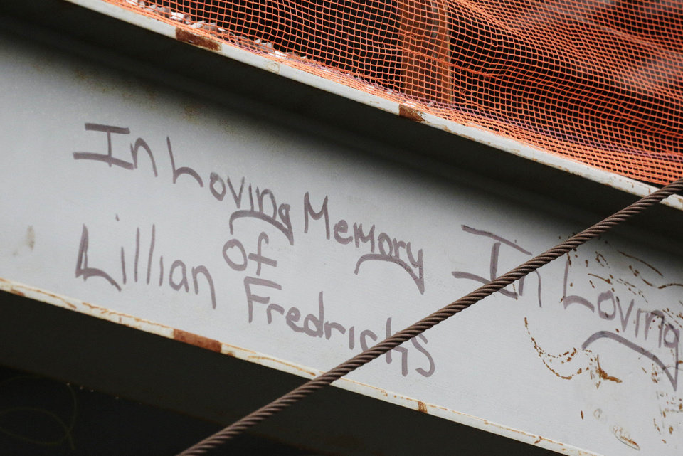 Photo - This Jan. 15, 2013 photo shows a tribute in graffiti to Lilian Fredricks that a construction worker left on a steel column on the 104th floor of One World Trade Center in New York. Fredericks was killed in the 2001 terror attacks. Workers finishing New York's tallest building at the World Trade Center are leaving their personal marks on the concrete and steel in the form of graffiti. (AP Photo/Mark Lennihan)