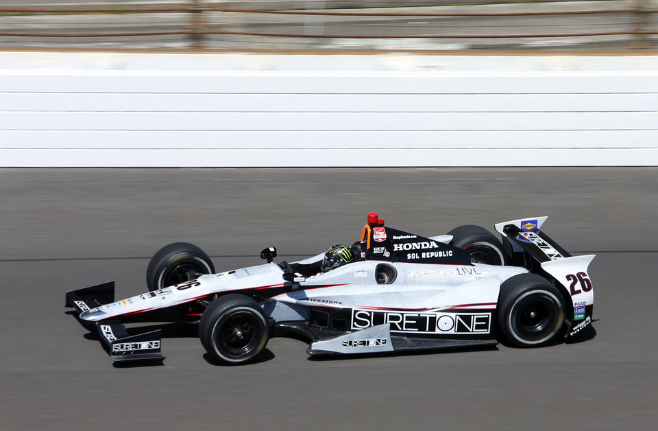Photo - Kurt Busch heads into the first turn on the final day of practice for the Indianapolis 500 IndyCar auto race at the Indianapolis Motor Speedway in Indianapolis, Friday, May 23, 2014. The 98th running of the Indianapolis 500 is Sunday. (AP Photo/Tom Strattman)