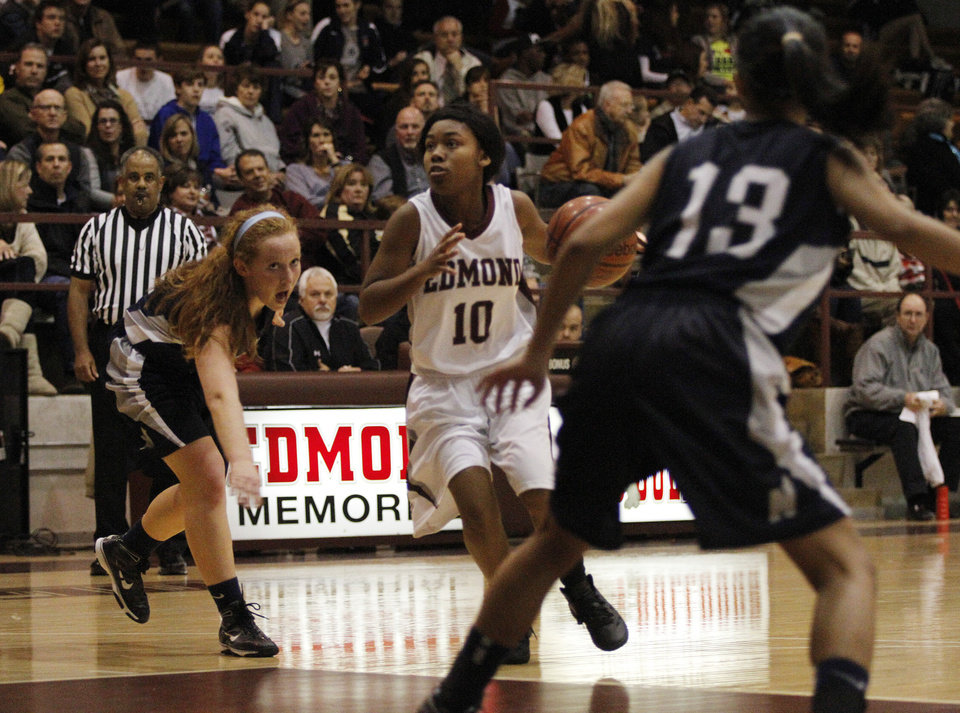 Edmond Memorial's Daijane Dillard (10) drives the ball in to the paint during a high school basketball game between Edmond Memorial and Edmond North at Edmond Memorial High School, Tuesday, Dec. 20, 2011.  Photo by Garett Fisbeck, The Oklahoman ORG XMIT: KOD