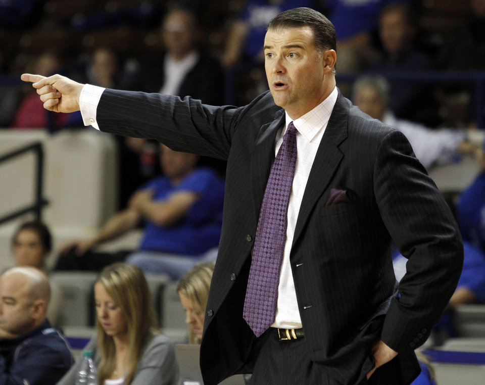 Photo - Kentucky head coach Matthew Mitchell directs his team during the second half of an NCAA college basketball game at Memorial Coliseum in Lexington, Ky., Sunday, Nov. 25, 2012. Kentucky won 100-34. (AP Photo/James Crisp)