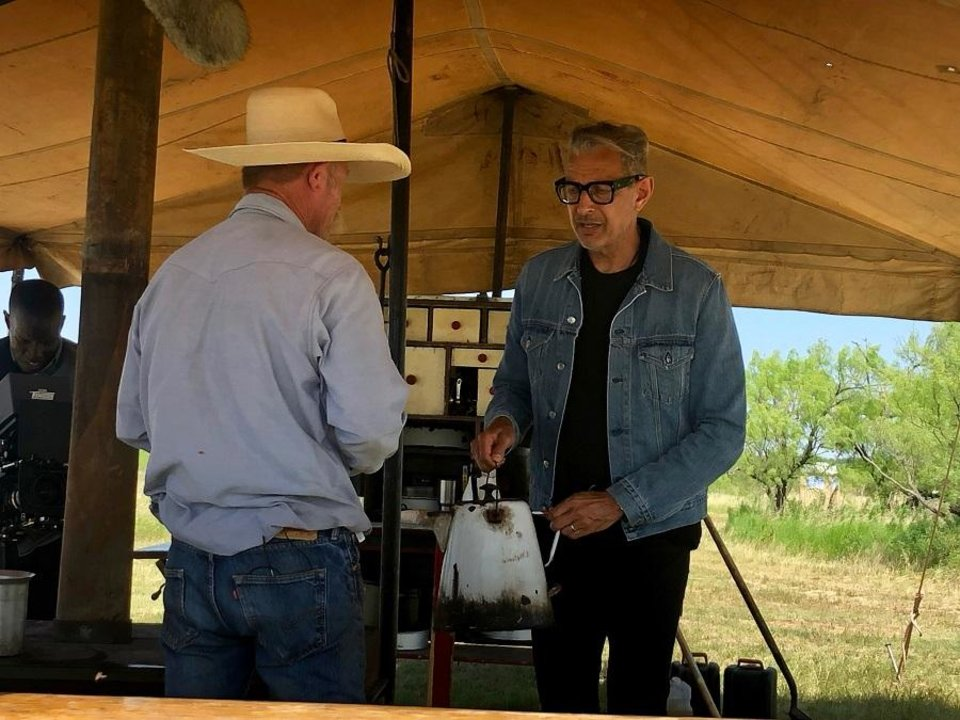 Photo - Oklahoma chuck wagon cook Kent Rollins shows Jeff Goldblum how to make cowboy coffee on the latest episode of the Disney+ series