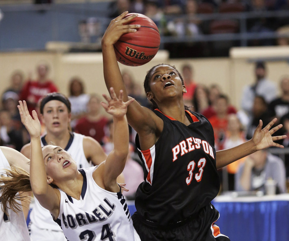 Photo - Preston guard Ki-Essence Shields grabs a rebound away from Cordell's Cherokee Mitchell during the Class 2A Girls State Championship game between Preston and Cordell at Jim Norick Arena at State Fair Park  on Saturday, Mar. 15, 2014.  Preston won,  45-41. Photo by Jim Beckel, The Oklahoman