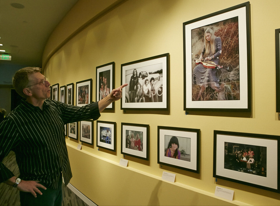 Photo - In this Friday, May 9, 2014 photo, Grammy Museum Executive Director Bob Santelli, left, comments on iconic photos by folk musician and photographer Henry Diltz on display at the Grammy Museum exhibit
