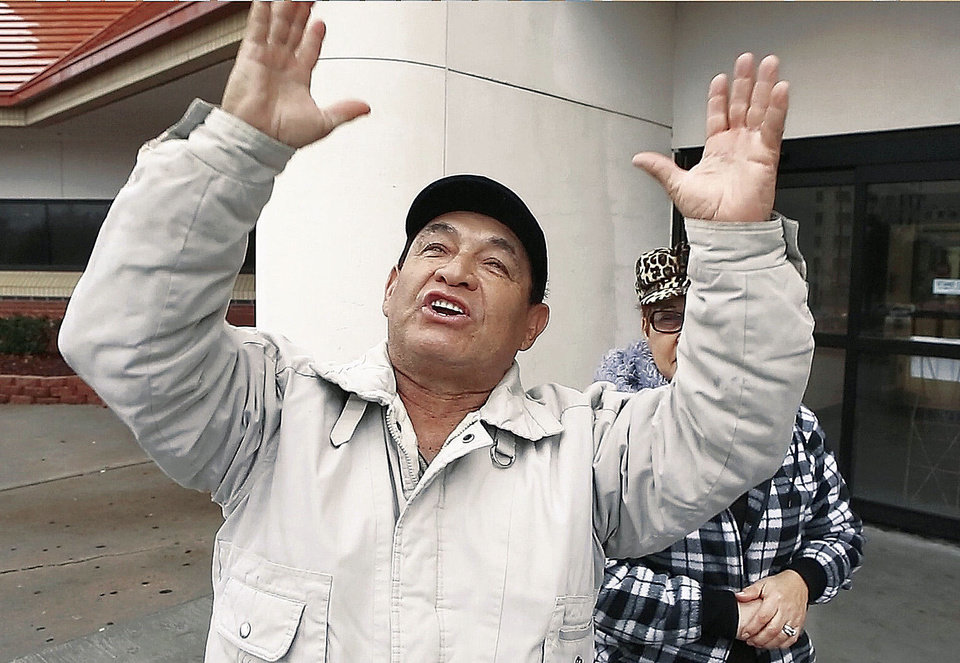 The father of Luis E. Ruiz gives praise to God on Monday after greeting his son, who had just been released from Oklahoma County jail. He raised his hands toward the sky in repetitive motions and shouted, �Thank you. Thank you. Thank you, Jesus Christ. Thank you.�  Photo by Jim Beckel, The Oklahoman