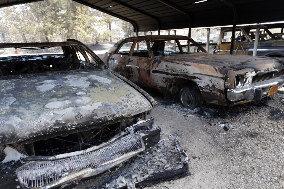 Burned cars are pictured , Sunday, Aug. 5, 2012, in Oak Grove community in Drumright, Okla., after wildfires moved through the area Saturday. Photo by Sarah Phipps, The Oklahoman