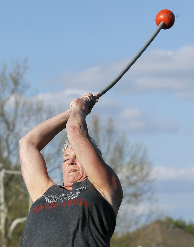 Photo -  Terri Ventress practices the hammer throw at Siler Park on Monday. [Photo by Nate Billings, The Oklahoman]