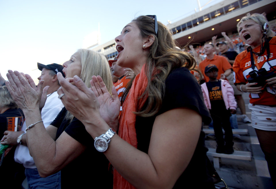 Photo - Melanie Weeden cheers during a college football game between the Oklahoma State University Cowboys (OSU) and the University of Arizona Wildcats at Boone Pickens Stadium in Stillwater, Okla., Thursday, Sept. 8, 2011. Photo by Sarah Phipps, The Oklahoman  ORG XMIT: KOD