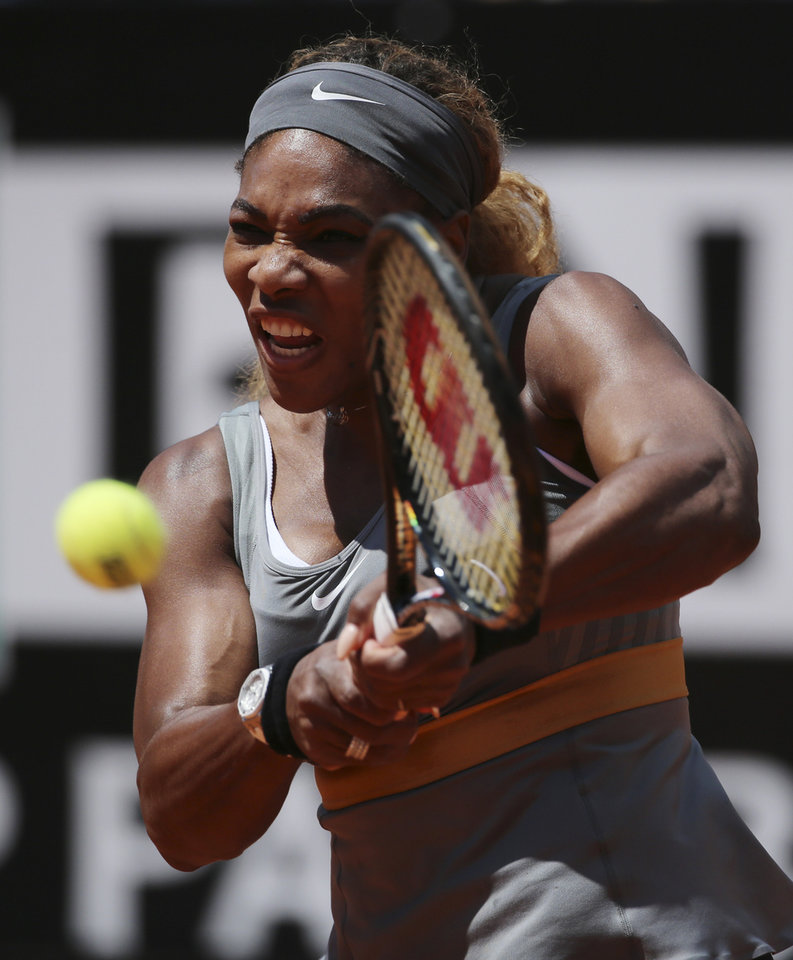 Photo - Serena Williams returns the ball to Italy's Sara Errani, during the final match against Italy's Sara Errani at the Italian open tennis tournament in Rome, Sunday, May 18, 2014. Serena Williams kept the crowd from being a factor in a 6-3, 6-0 victory over 10th-seeded Sara Errani to win the Italian Open for the third time Sunday. (AP Photo/Gregorio Borgia)