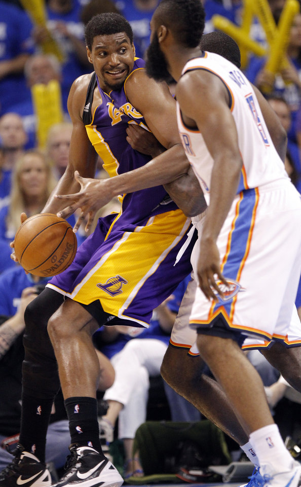 Los Angeles' Andrew Bynum drives against Oklahoma City's Kendrick Perkins and James Harden during Game 2 in the second round of the NBA playoffs between the Oklahoma City Thunder and the L.A. Lakers at Chesapeake Energy Arena on Wednesday,  May 16, 2012, in Oklahoma City, Oklahoma. Photo by Chris Landsberger, The Oklahoman