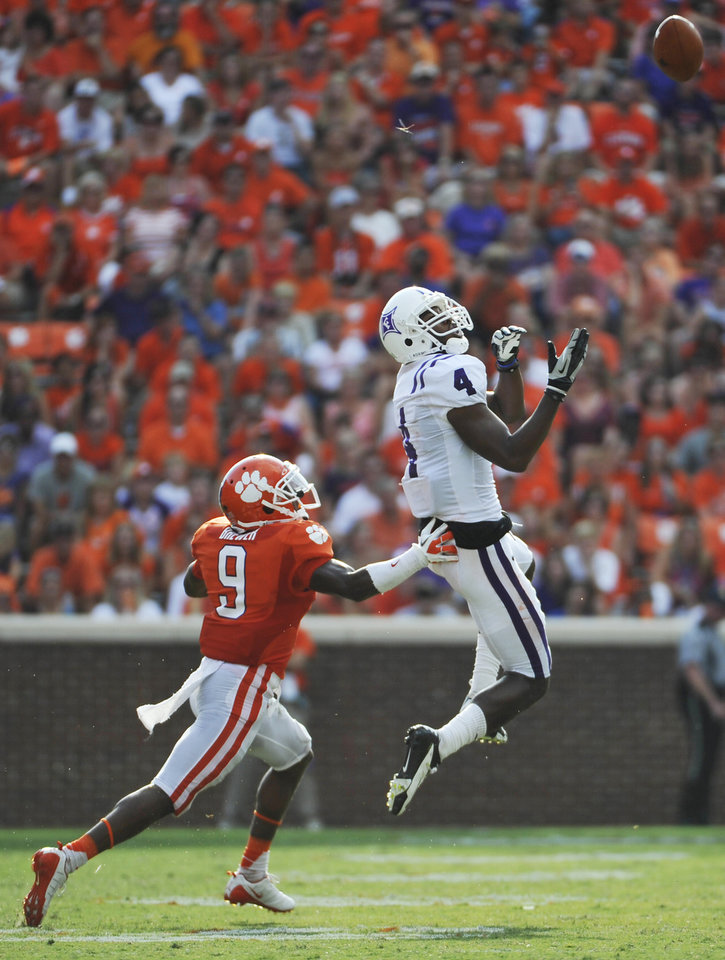 Photo -   Furman's Ryan Culbreath (4) goes up for a catch as Clemson's Xavier Brewer (9) defends during the second half of an NCAA college football game Saturday, Sept. 15, 2012, in Clemson, S.C. Clemson won 41-7. (AP Photo/Rainier Ehrhardt)