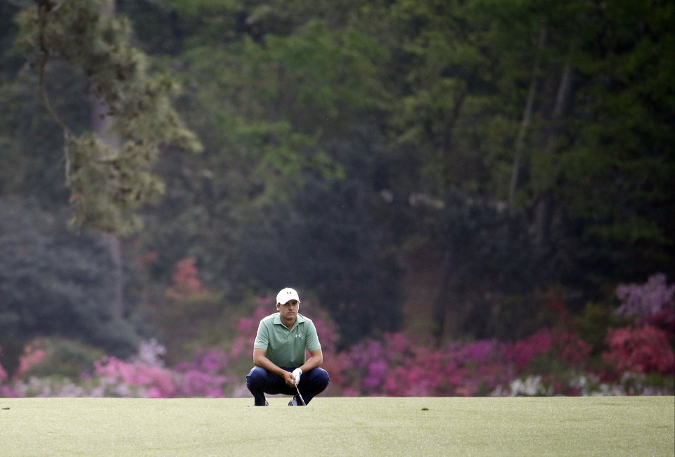 Photo - Jordan Spieth reacts to his shot off the 14th fairway during the fourth round of the Masters golf tournament Sunday, April 13, 2014, in Augusta, Ga. (AP Photo/Darron Cummings)