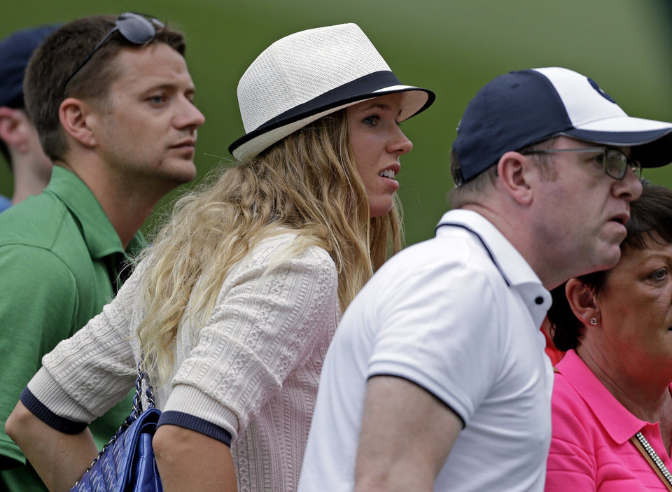 Photo - Tennis player Caroline Wozniacki watches Rory McIlroy, of Northern Ireland, during the first round of the Masters golf tournament Thursday, April 11, 2013, in Augusta, Ga. (AP Photo/David Goldman)
