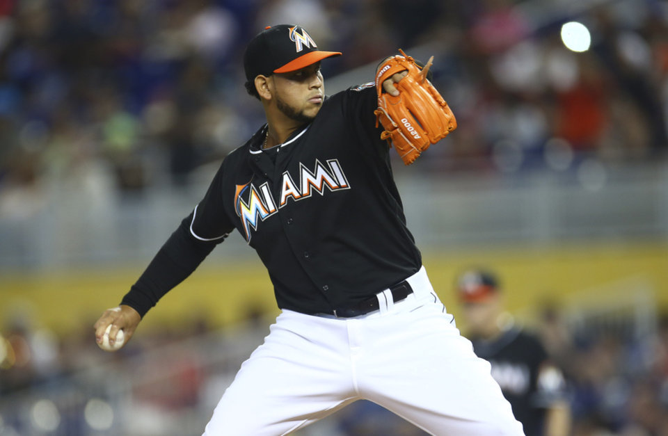 Photo - Miami Marlins starter Henderson Alvarez throws to the Seattle Mariners during the first inning of a baseball game in Miami, Saturday, April 19, 2014.  (AP Photo/J Pat Carter)