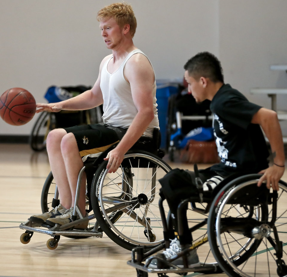 Jake Wiig drives the ball past Michael Thompkins while competing in the three on three basketball game during the Endeavor Games at the University of Central Oklahoma on Friday, June 7, 2013 in Edmond, Okla.  Photo by Chris Landsberger, The Oklahoman