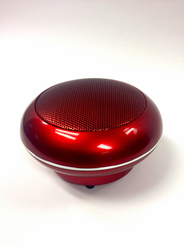 Photo - Divoom's Bluetune-Pop speaker is a small button-like speaker that plays music from mobile devices and offers rich pop-out bass sounds. PHOTO BY LILLIE-BETH BRINKMAN, THE OKLAHOMAN.
