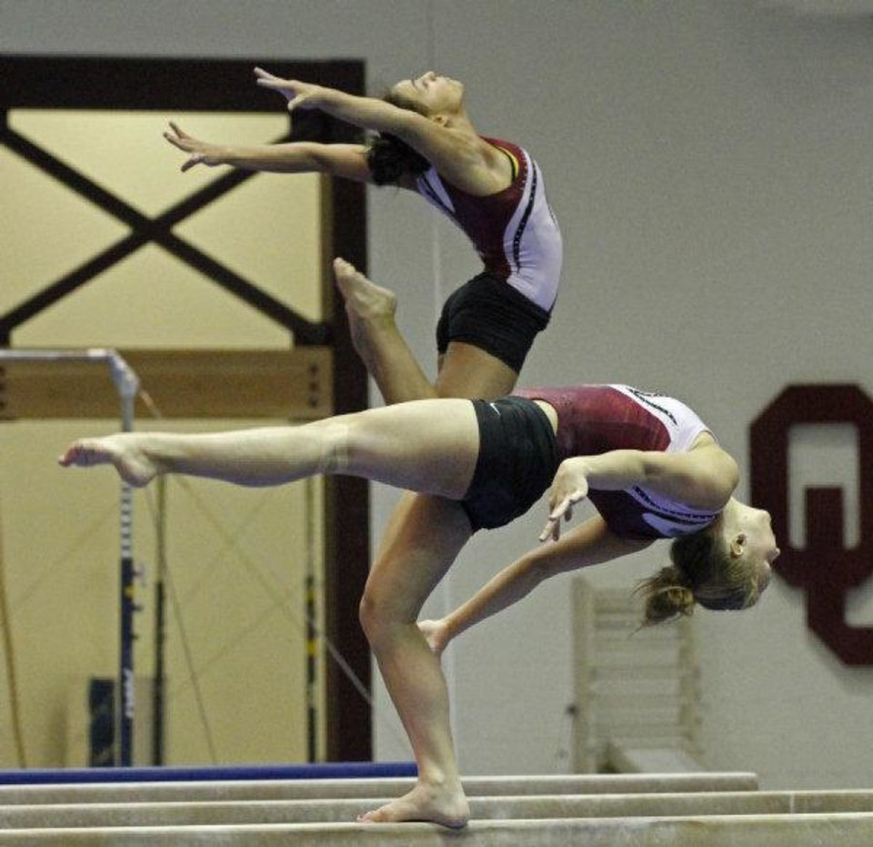 Photo - University of Oklahoma (OU) gymnasts Madison Mooring (back) and Natalie Ratcliff practice on the beam on Wednesday, March 30, 2011, in Norman, Okla.   Photo by Steve Sisney, The Oklahoman ORG XMIT: KOD  STEVE SISNEY - THE OKLAHOMAN
