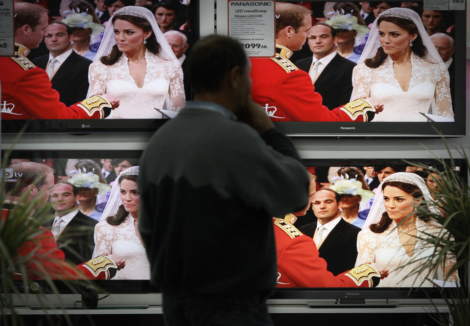 Photo - Bulgarian watches the British Royal Wedding  of HRH Prince William  and Kate Middleton, on TV sets on display at a store in Sofia, Friday, Apr.29 , 2011. The Royal Wedding has been broadcasted live by two biggest Bulgarian national-wide TV channels. (AP Photo/Valentina Petrova) ORG XMIT: VP101