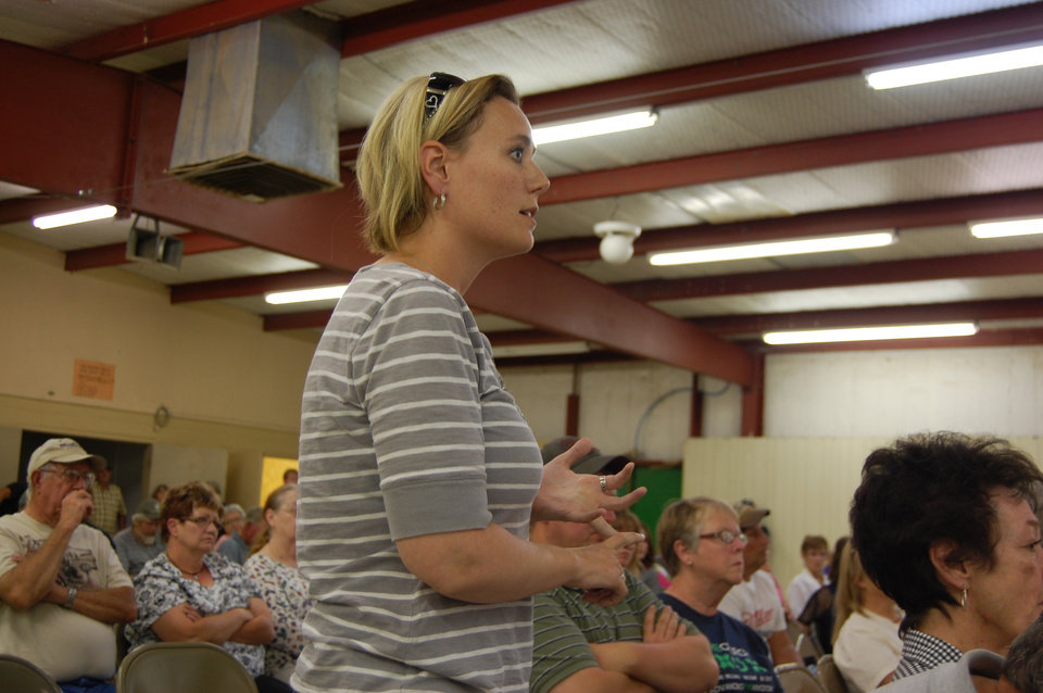 Photo -  Jennifer Adee, a resident of Boise City and a concerned parent, talks about run-ins with members of a fundamentalist sect of the Church of Latter Day Saints at a town hall meeting on July 1, 2014. Photo by Andrew Knittle, The Oklahoman.