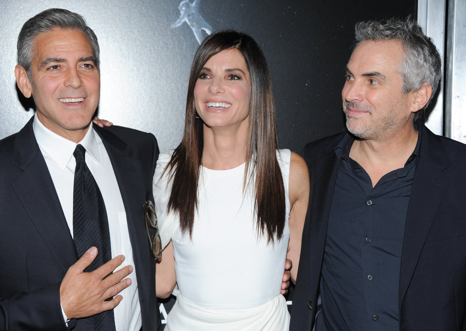 "Actor George Clooney, left, actress Sandra Bullock and director Alfonso Cuaron pose together at the premiere of ""Gravity"" at the AMC Lincoln Square Theaters on Tuesday, Oct. 1, 2013, in New York. (Photo by Evan Agostini/Invision/AP) ORG XMIT: NYEA129"