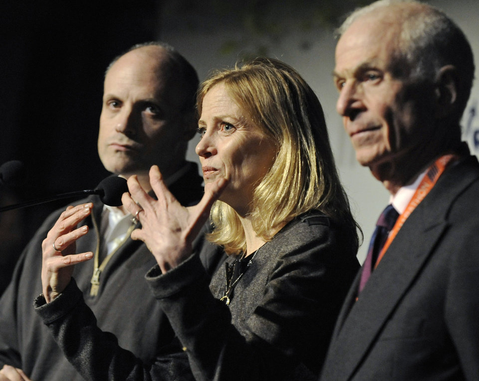 Photo -   Mary Wittenberg, president of the New York Road Runners, speaks during a news conference Friday, Nov. 2, 2012, in New York, after New York Mayor Michael Bloomberg canceled Sunday's New York City Marathon. At left is Howard Wolfson, deputy mayor for government affairs and communication; at right is George Hirsch, chairman of the board of New York Road Runners. Bloomberg canceled the race after mounting criticism that this was not the time for a race, as the city continues to recover from Superstorm Sandy. (AP Photo/ Louis Lanzano)