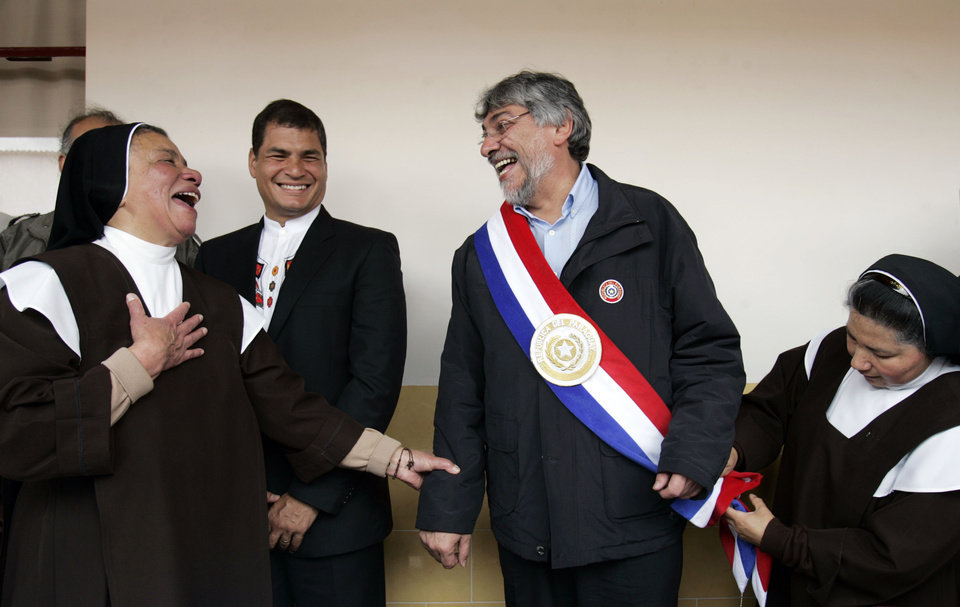 Photo -   FILE - In this June 16, 2008 file photo, Paraguay's President-elect Fernando Lugo, second from right, is fitted for his presidential sash by sister Graciela, as Ecuador's President Rafael Correa, second left, and Mother Superior Lucia of the Carmelitas order, left, look on in Guaranda, Ecuador. An impeachment process ended with the ouster of Lugo on Friday, June 22, 2012. The Senate tried him on five charges of malfeasance in office, including an alleged role in a deadly confrontation between police and landless farmers that left 17 dead. Lugo will be replaced by Vice President Federico Franco. (AP Photo/Dolores Ochoa, File)