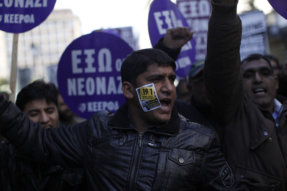 Photo - Mourners shout slogans during a protest against racist attacks and the murder of  Shehzad Luqman, a Pakistani immigrant who was killed on Thursday after being stabbed by suspected extreme rightists,  in Athens on Saturday, Jan. 19 2013. An estimated 3,000 people marched  through central Athens in protest at a spate of anti-immigrant attacks that turned fatal Thursday when a 27-year-old Pakistani immigrant was stabbed by suspected extreme rightists.  (AP Photo/Kostas Tsironis)