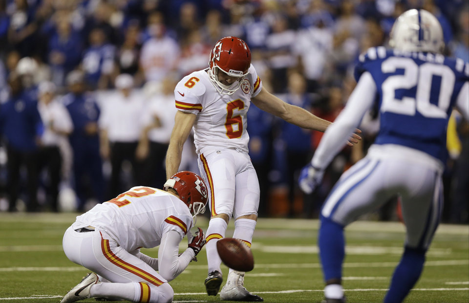 Photo - Kansas City Chiefs kicker Ryan Succop (6) kicks a 19-yard field goal against the Indianapolis Colts during the first half of an NFL wild-card playoff football game Saturday, Jan. 4, 2014, in Indianapolis. (AP Photo/Michael Conroy)