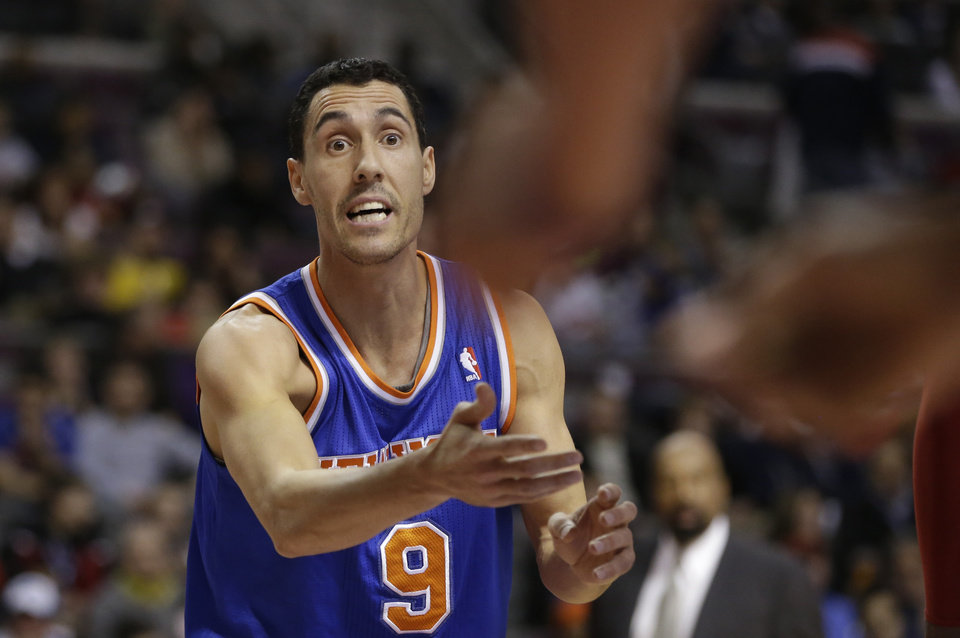 Photo - New York Knicksguard Pablo Prigioni (9) of Argentina disputes a call during the first half of an NBA basketball game against the Detroit Pistons in Auburn Hills, Mich., Monday, March 3, 2014. (AP Photo/Carlos Osorio)
