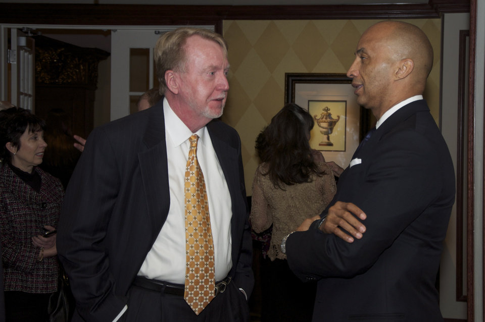 Photo -  Journalist Mike Boettcher, left, talks to news correspondent Byron Pitts. PHOTO BY M. TIM BLAKE, FOR THE OKLAHOMAN