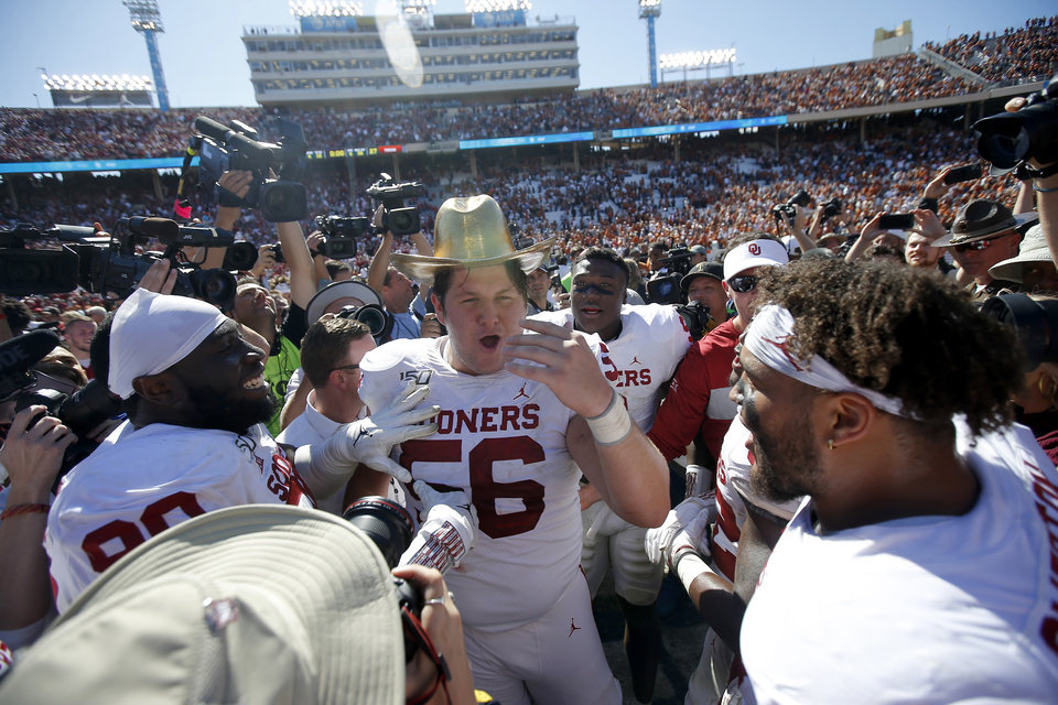 Photo - Oklahoma offensive lineman Creed Humphrey (56) celebrate with the Golden Hat during the Red River Showdown college football game between the University of Oklahoma Sooners (OU) and the Texas Longhorns (UT) at Cotton Bowl Stadium in Dallas, Saturday, Oct. 12, 2019. Oklahoma won 34-27. [Bryan Terry/The Oklahoman]