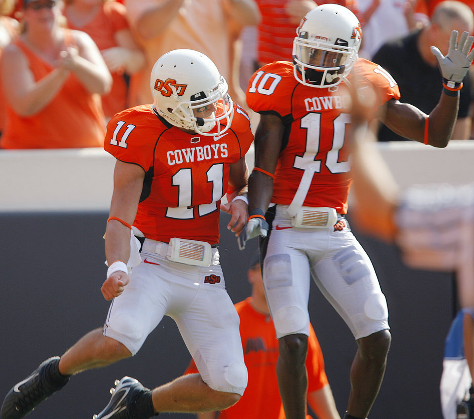 Oklahoma State's Zac Robinson (11) and Tommy Devereaux (10) celebrate after Robinson's rushing touchdown during the first half of the college football game between the Oklahoma State University Cowboys (OSU) and the Texas Tech University Red Raiders (TTU) at Boone Pickens Stadium  on Saturday, Sept. 22, 2007, in Stillwater, Okla. 