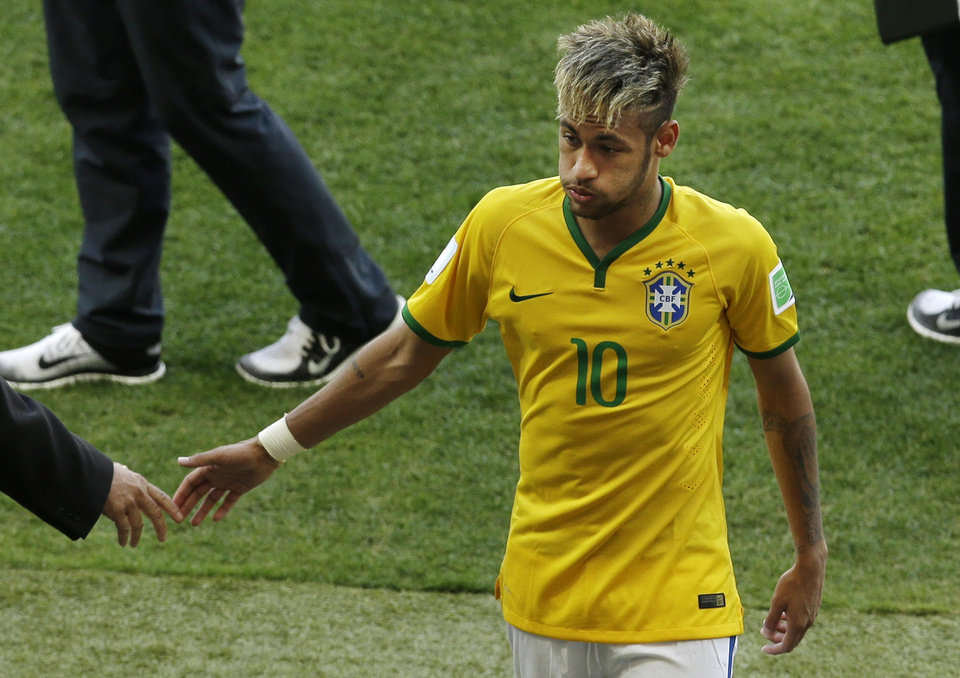 Photo - Brazil's Neymar leaves the pitch after the World Cup round of 16 soccer match between Brazil and Chile at the Mineirao Stadium in Belo Horizonte, Brazil, Saturday, June 28, 2014. Brazil won 3-2 on penalties after the match ended 1-1 draw after extra-time. (AP Photo/Hassan Ammar)