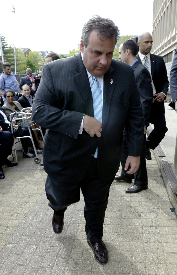 Photo - New Jersey Gov. Chris Christie walks to a podium to address the media during the groundbreaking ceremony for the Technology Enhanced Accelerated Learning Center at Essex County Newark Tech, Tuesday, May 7, 2013, in Newark, N.J. Reports say Christie secretly underwent a weight-loss surgery in February, when a band was placed around his stomach to restrict the amount of food he can eat. (AP Photo/Julio Cortez)