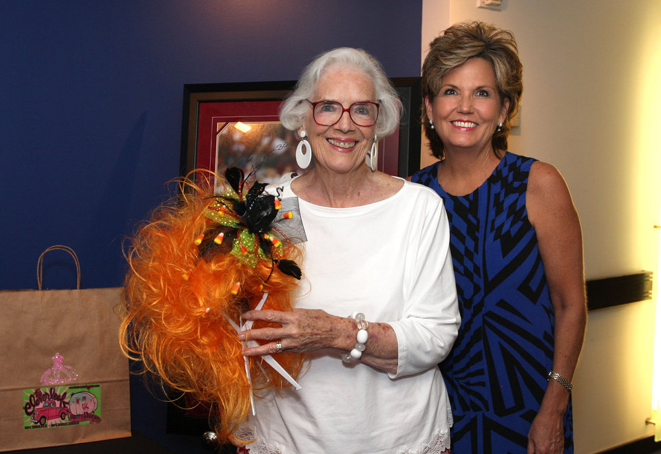 Photo -  Joan Gilmore and Marion Paden check out the auction items.