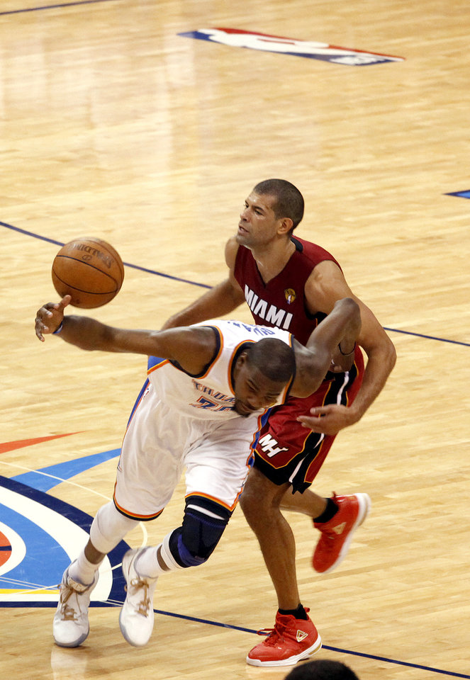 Oklahoma City's Kevin Durant (35) fights Miami's Shane Battier (31) for a ball during Game 1 of the NBA Finals between the Oklahoma City Thunder and the Miami Heat at Chesapeake Energy Arena in Oklahoma City, Tuesday, June 12, 2012. Photo by Sarah Phipps, The Oklahoman