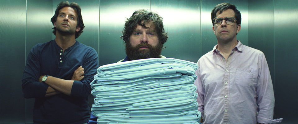This film publicity image released by Warner Bros. Pictures shows Bradley Cooper as Phil, left, Zach Galifianakis as Alan, center, and Ed Hlems as Stu in a scene from