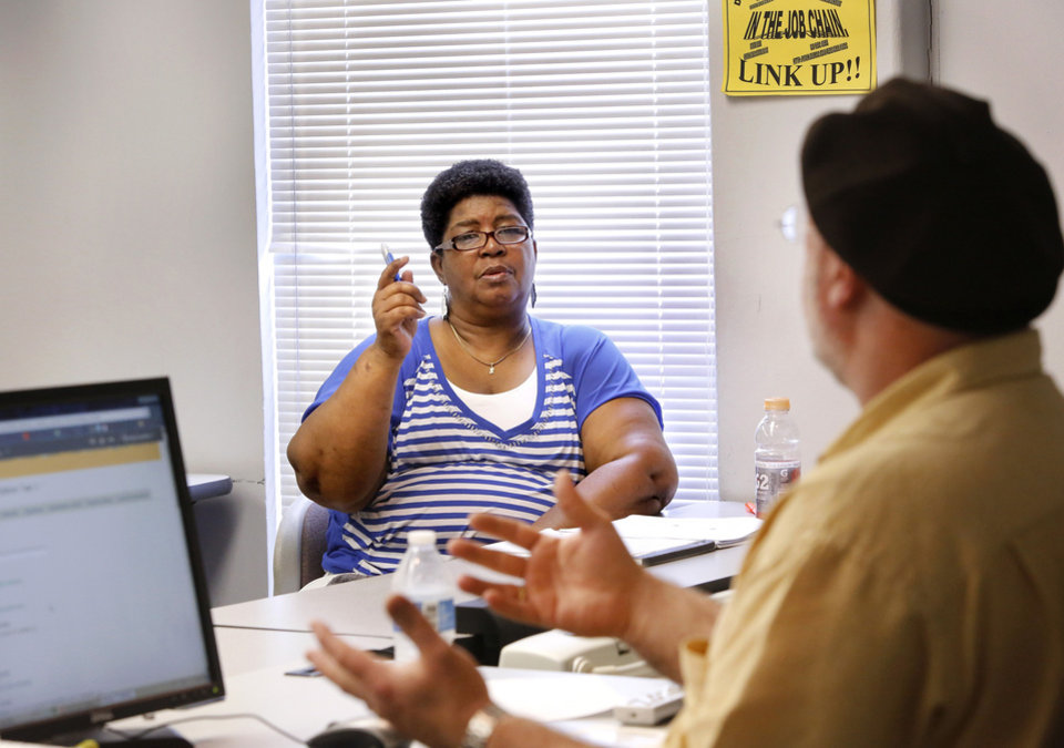 Photo - Craig Dawkins teaches a personal finance class at Rose State College in Midwest City  that includes a few adult college students. Veda Lewis makes a point while asking a question from her front row seat on Thursday. Photo by Jim Beckel, The Oklahoman.  Jim Beckel - THE OKLAHOMAN