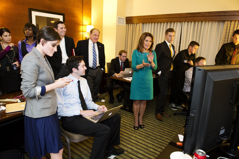 Photo -   Rep. Michele Bachmann claps as she watches election results at the Republican Party of Minnesota Election Night Party, Tuesday, Nov. 6, 2012, at the Hilton Minneapolis Bloomington in Bloomington, Minn. (AP Photo/The Star Tribune, Glen Stubbe) MANDATORY CREDIT; ST. PAUL PIONEER PRESS OUT; MAGS OUT; TWIN CITIES TV OUT