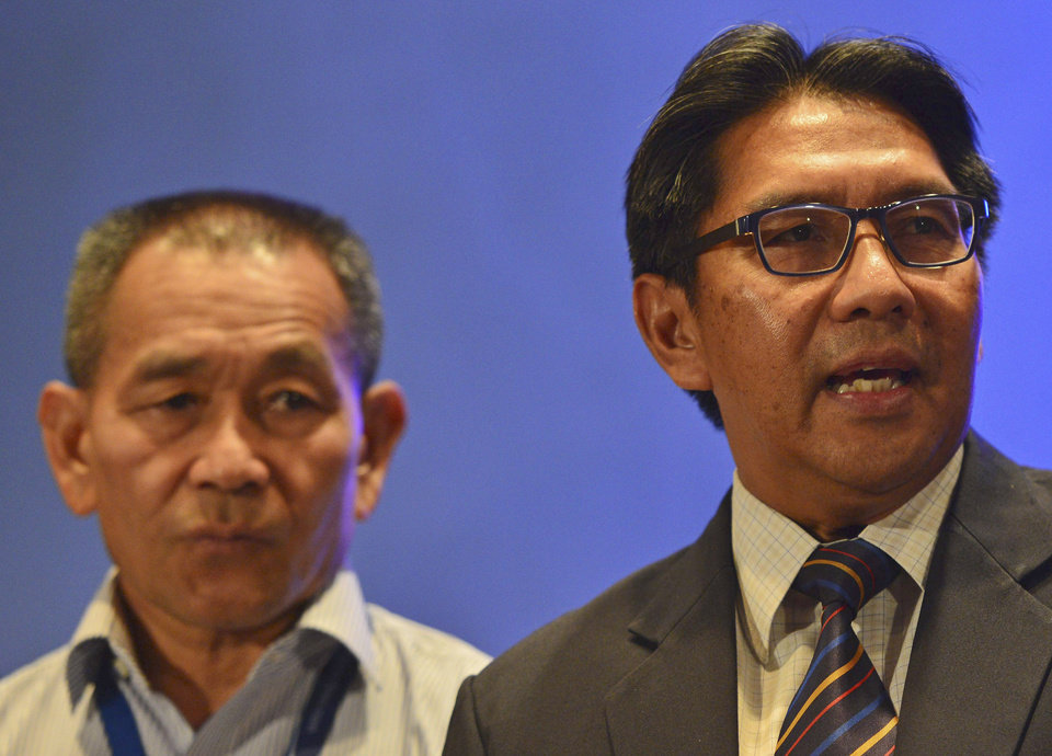 "Photo - Malaysia's Department of Civil Aviation director general Azharuddin Abdul Rahman, right, speaks as Malaysia Airlines Group Chief Executive Ahmad Jauhari Yahyain listens during a press conference at a hotel in Sepang, Malaysia, Monday, March 10, 2014. Dozens of ships and aircraft have failed to find any piece of the missing Boeing 777 jet that vanished more than two days ago above waters south of Vietnam as investigators pursued ""every angle"" to explain its disappearance, including hijacking, Malaysia's civil aviation chief said Monday. (AP Photo)"