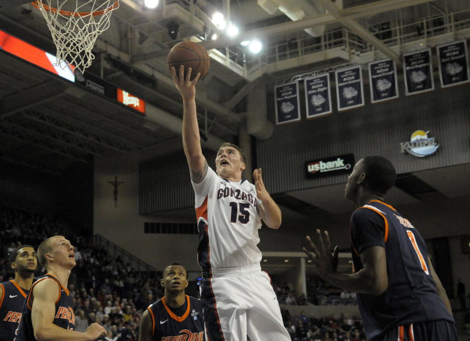 Photo - Gonzaga's Ryan Spangler (15) drives past the Pepperdine defense in the second half of an NCAA college basketball game on Thursday, Jan. 5, 2012, in Spokane, Wash. Gonzaga defeated Pepperdine 73-45. (AP Photo/Jed Conklin) ORG XMIT: WAJC111