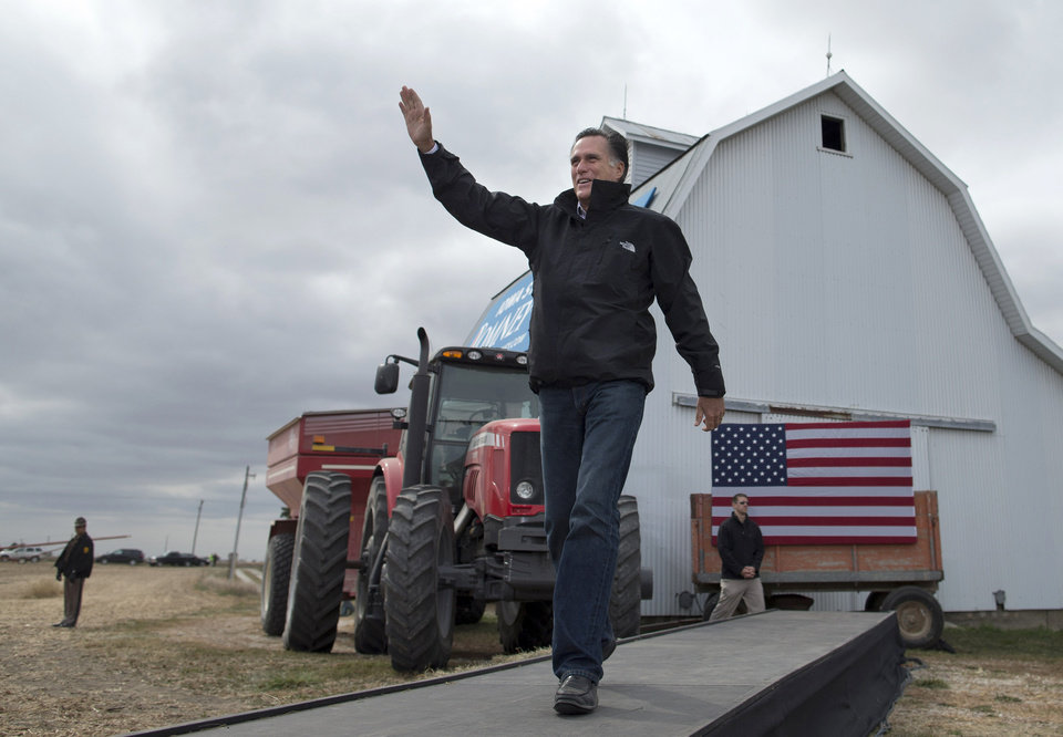 Republican presidential candidate, former Massachusetts Gov. Mitt Romney waves as he arrives for a campaign rally, Tuesday, Oct. 9, 2012, in Van Meter, Iowa. (AP Photo/ Evan Vucci)