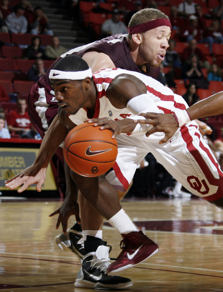 Photo - OU's Calvin Newell Jr. (11) dribbles past Freddy Obame Obame (00) of Maryland Eastern Shore during the men's college basketball game between Maryland Eastern Shore and Oklahoma at Lloyd Noble Center in Norman, Okla., Monday, January 3, 2011. Photo by Nate Billings, The Oklahoman