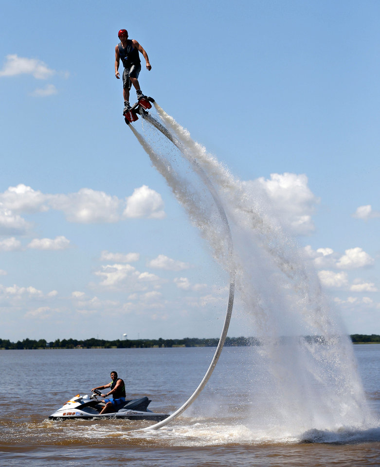 Jeff Luft, with Gulf State Flyboard,rides a Zapata Flyboard on Lake Overholser as Bobby Ecker controls the power from a personal watercraft, Tuesday, June 18, 2013. Photo by Bryan Terry, The Oklahoman