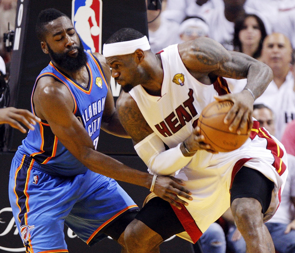 Oklahoma City\'s James Harden (13) defends Miami\'s LeBron James (6) during Game 3 of the NBA Finals between the Oklahoma City Thunder and the Miami Heat at American Airlines Arena, Sunday, June 17, 2012. Photo by Bryan Terry, The Oklahoman