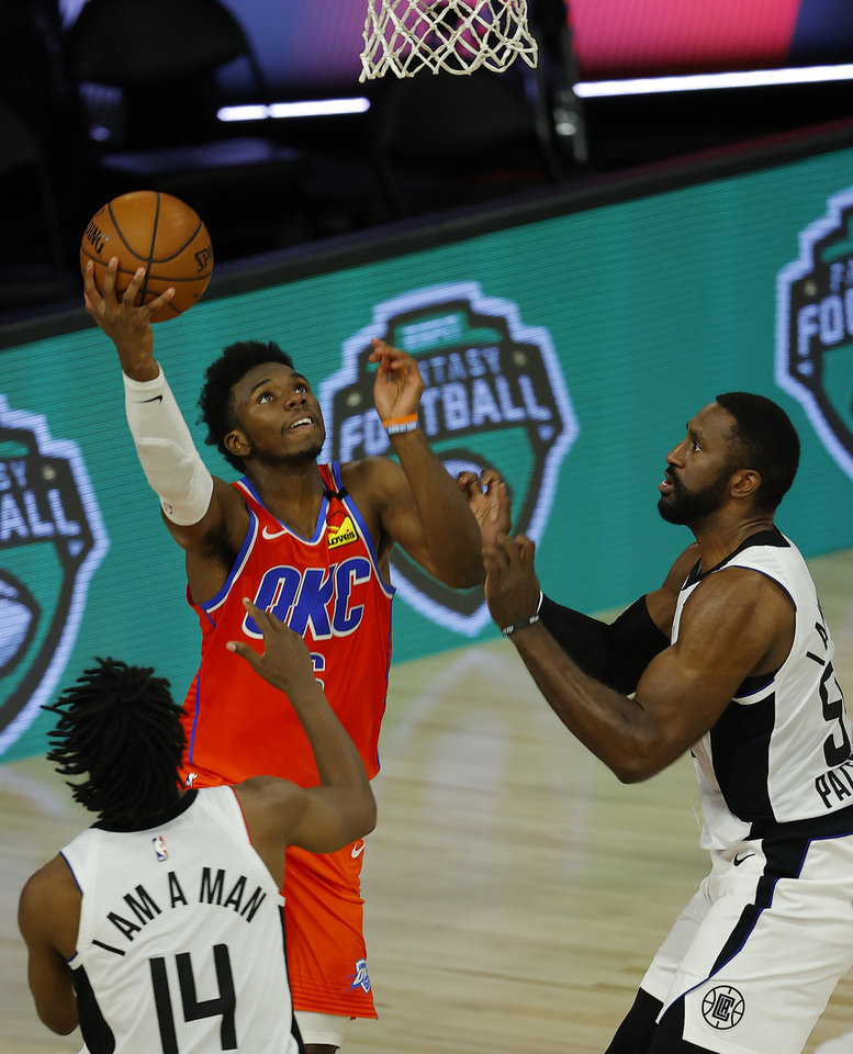 Photo - Aug 14, 2020; Lake Buena Vista, Florida, USA; Hamidou Diallo #6 of the Oklahoma City Thunder goes up for a basket as Terance Mann #14 of the LA Clippers looks on during the fourth quarter at The Field House at ESPN Wide World of Sports Complex. Mandatory Credit: Mike Ehrmann/Pool Photo-USA TODAY Sports