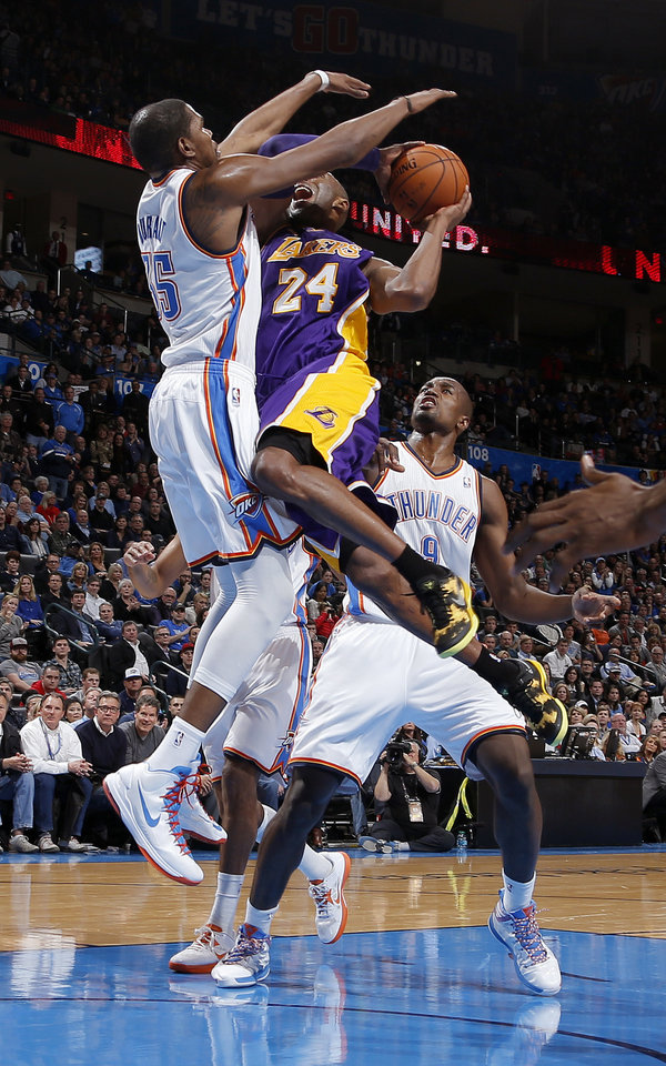 Oklahoma City\'s Kevin Durant (35) and Serge Ibaka (9) defend Los Angeles\' Kobe Bryant (24) during an NBA basketball game between the Oklahoma City Thunder and the Los Angeles Lakers at Chesapeake Energy Arena in Oklahoma City, Tuesday, March. 5, 2013. Photo by Bryan Terry, The Oklahoman